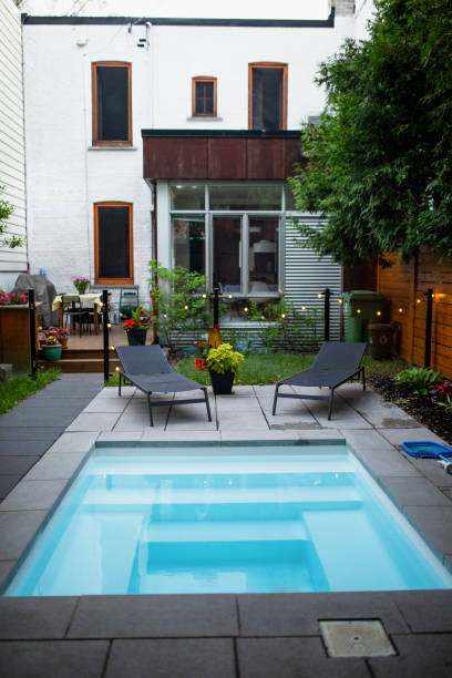 Back yard with a small swimming pool stock photo
