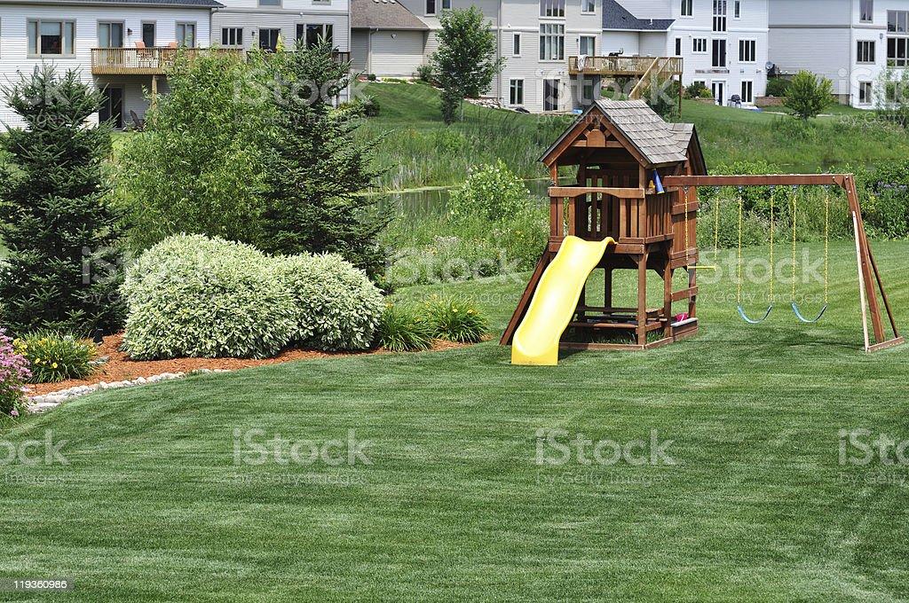 Back Yard Wooden Swing Set royalty-free stock photo