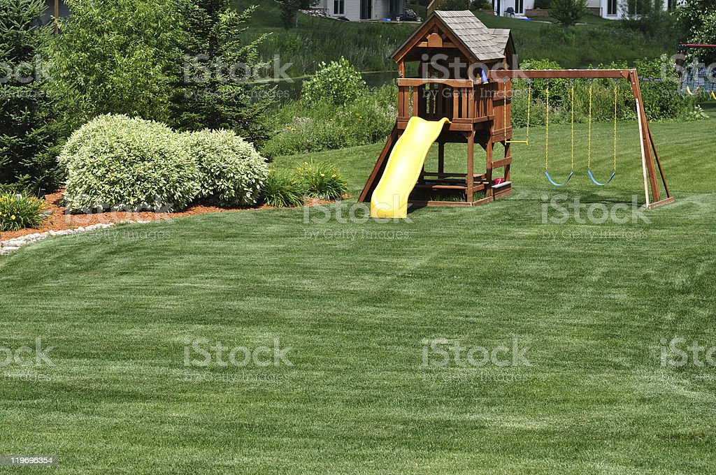 Back Yard Wooden Swing Set royalty-free stock photo