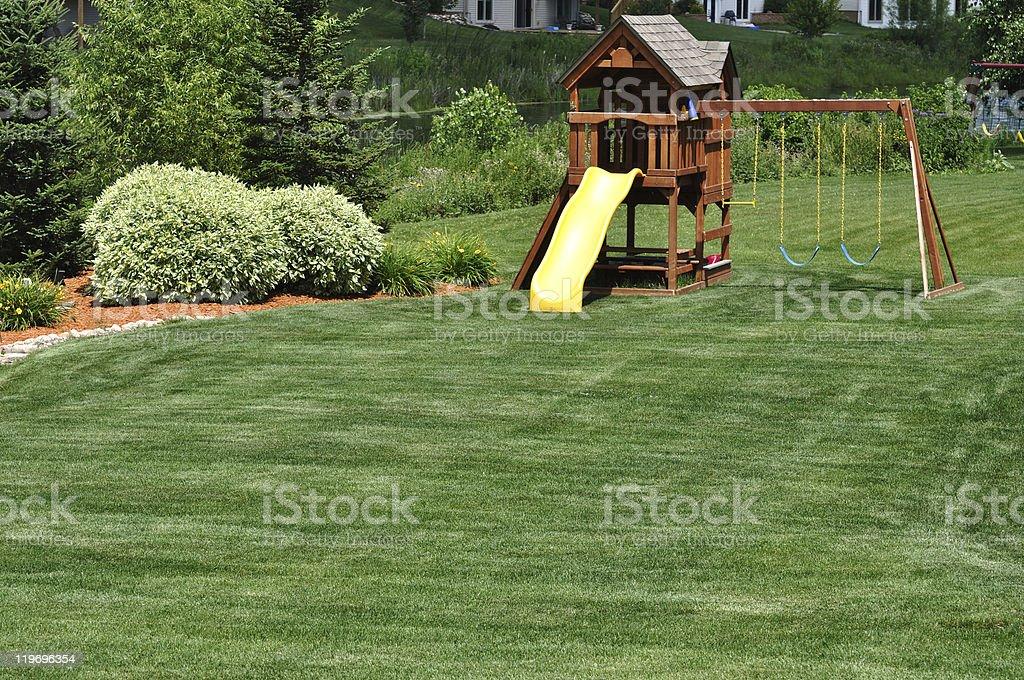 Back Yard Wooden Swing Set stock photo