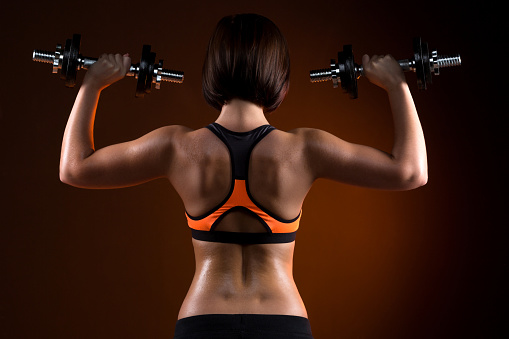 back young fitness girls with dumbbells