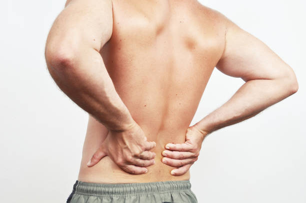 backache - low section stock photos and pictures