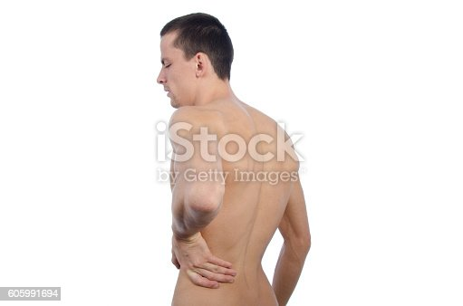 821012164istockphoto Backache. Young man and the pain. 605991694