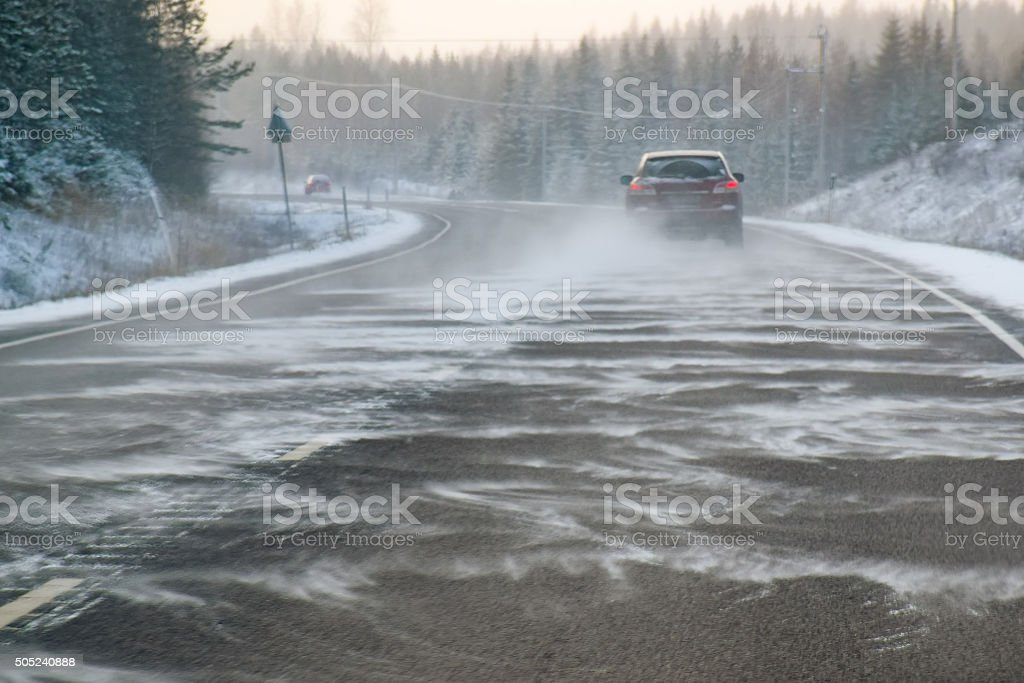 Backcountry road snowstorm stock photo