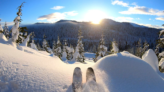 Sunny and snowy mountain scene in distance