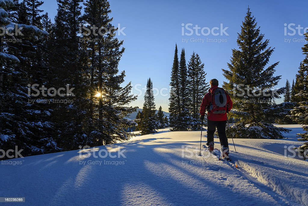 Backcountry Skier Ski Touring High in Mountains stock photo