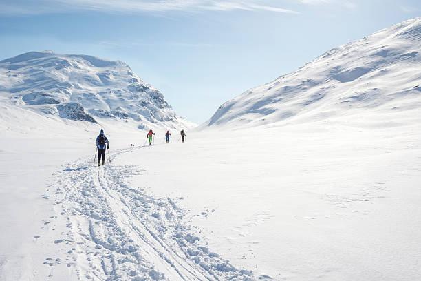 Backcountry skiers in Jotunheimen National Park stock photo