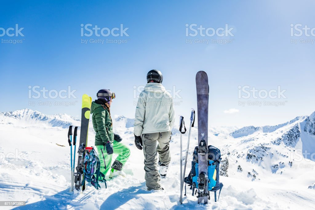 Backcountry skiers looking at the mountains stock photo