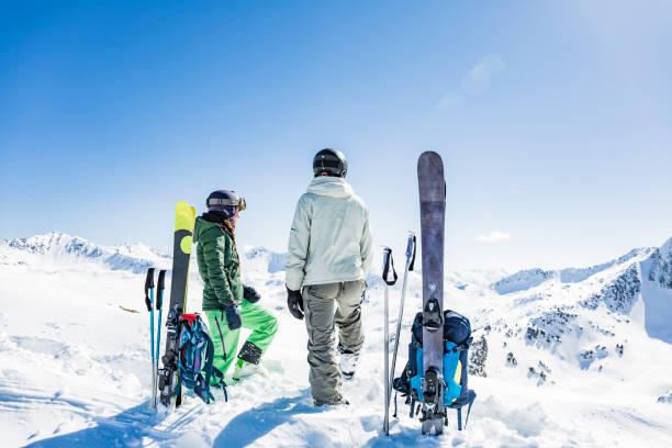 Backcountry skiers looking at the mountains Backcountry skiers looking at the mountains in the Pyrenees Val d'Aran Catalonia Spain lleida stock pictures, royalty-free photos & images