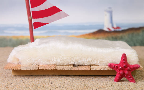 A backdrop prop for newborn babies of a sailboat on the beach. stock photo