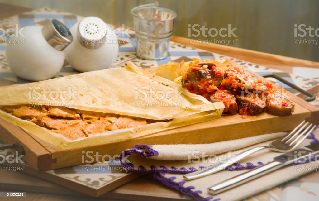 backed meat in paper with vegetables royalty-free stock photo