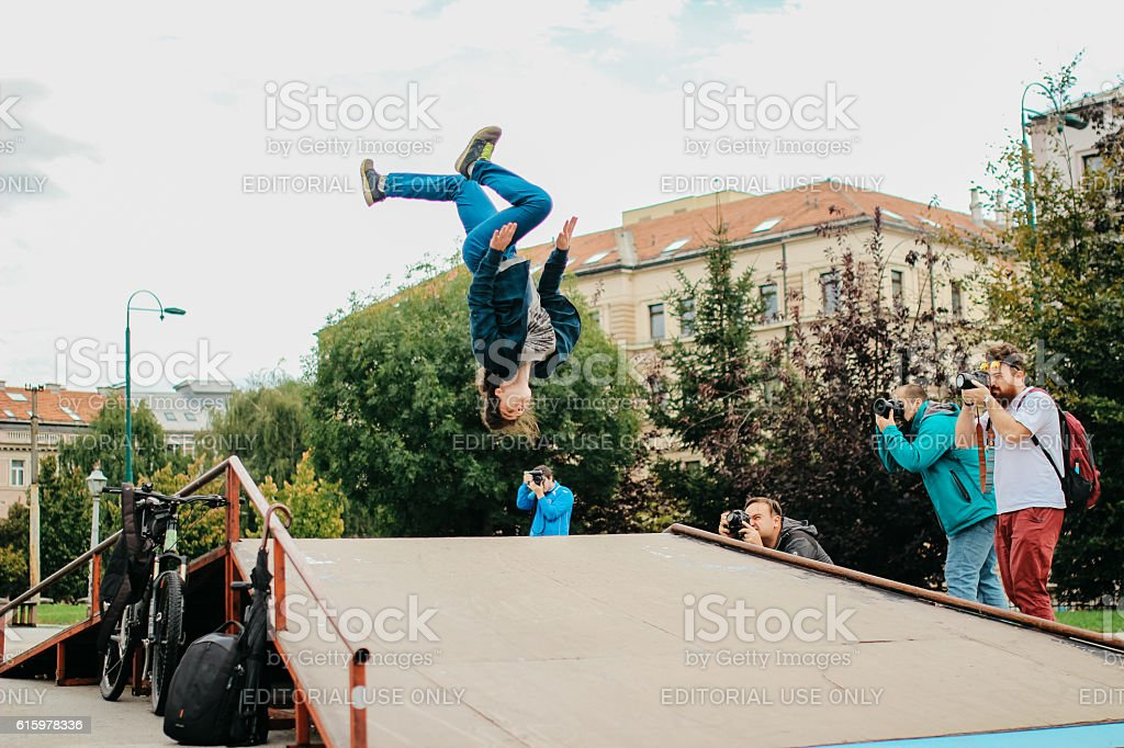 Backflip in front of friends in Skate Park stock photo