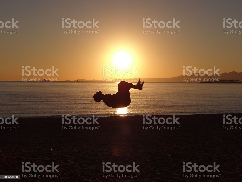 Backflip in front of the sun stock photo