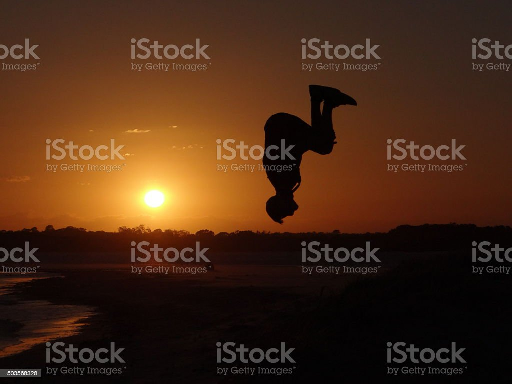 Backflip in front of the sunset stock photo