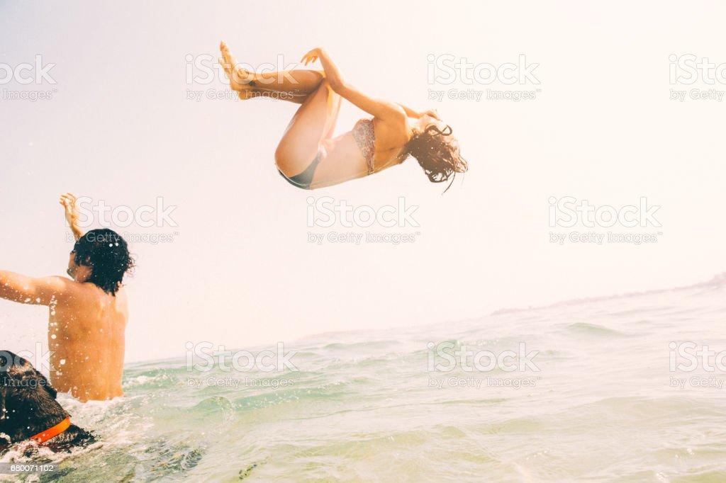 Backflip into the sea stock photo