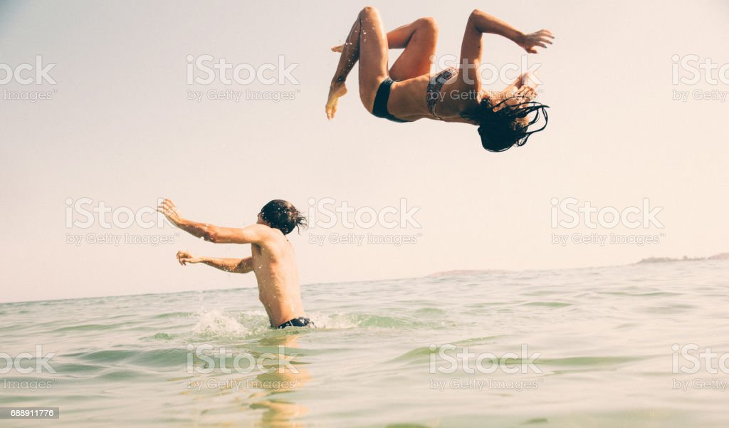 Backflip into the sea stock photo