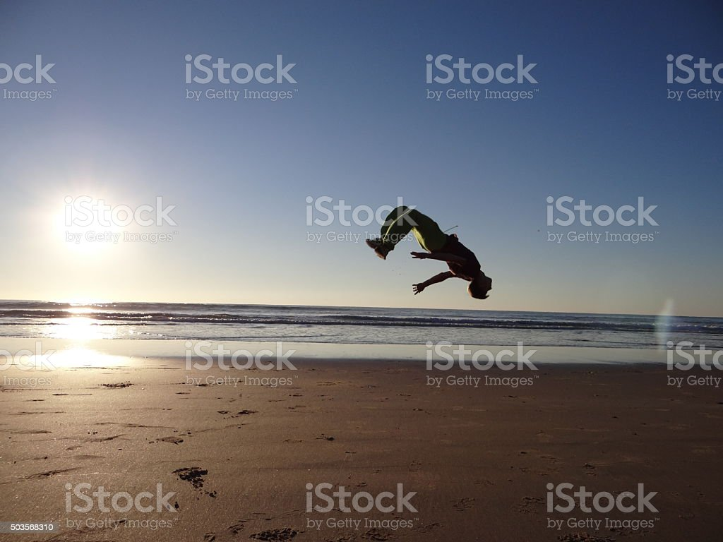 Backflip on the beach stock photo