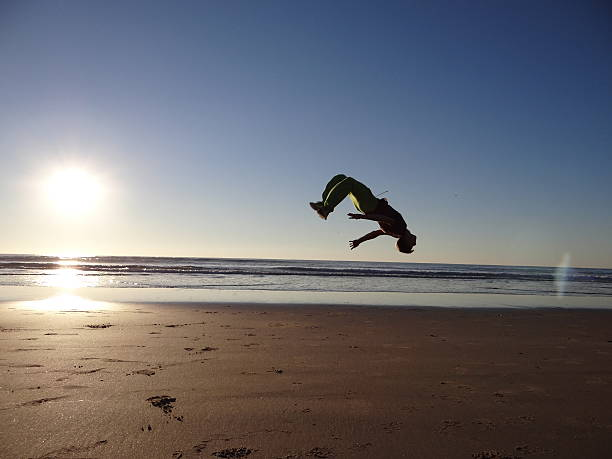 Backflip on the beach stock photo