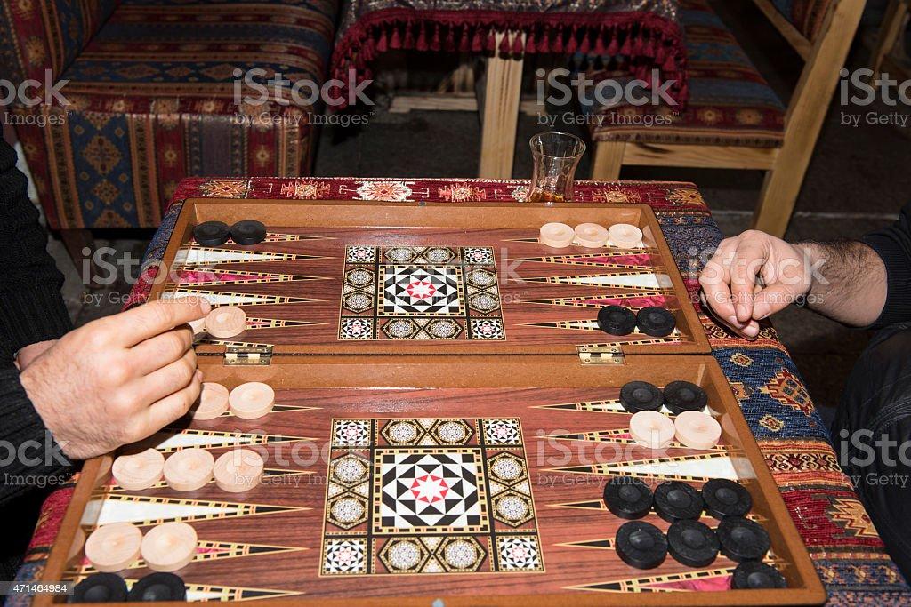 Backgammon board and players stock photo