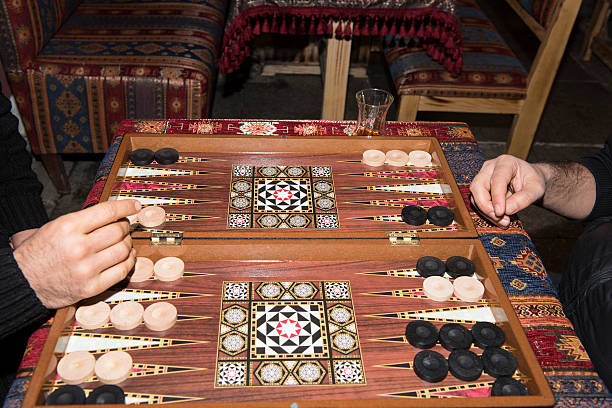Backgammon board and players stock photo