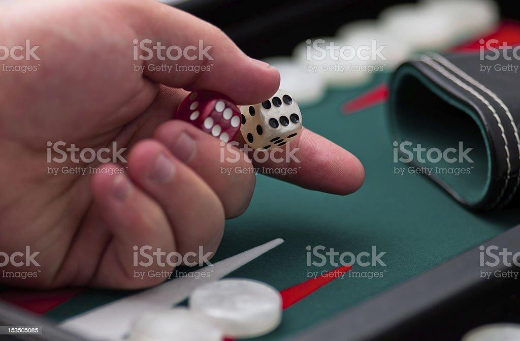 Backgammon dice and hand royalty-free stock photo