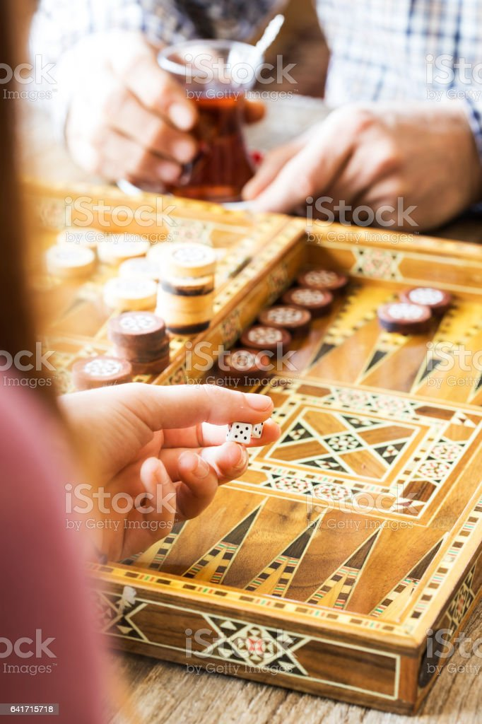 Backgammon game with two dice stock photo