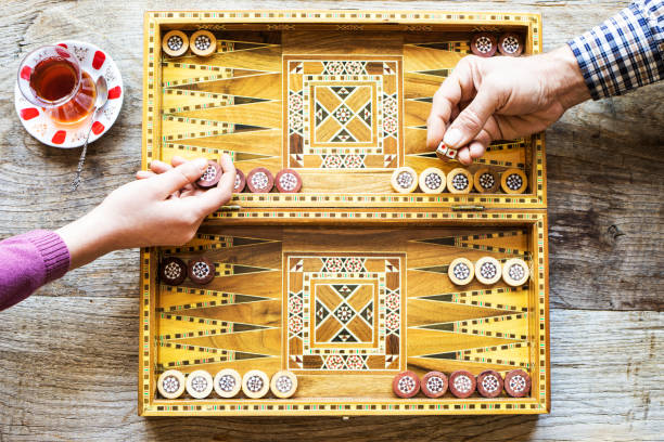 backgammon game with two dice - backgammon stock pictures, royalty-free photos & images