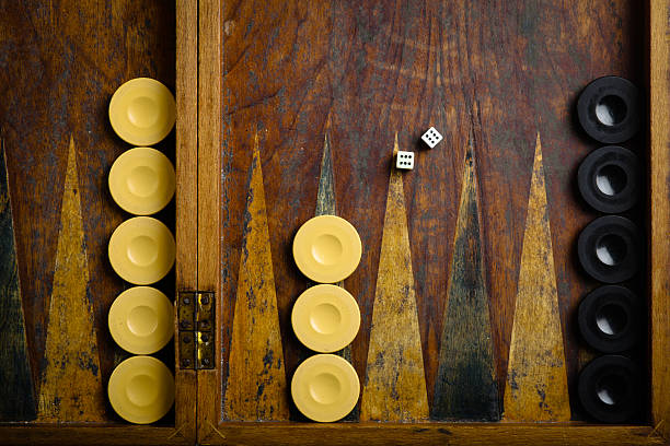 Backgammon Color detail of a Backgammon game with two dice backgammon stock pictures, royalty-free photos & images