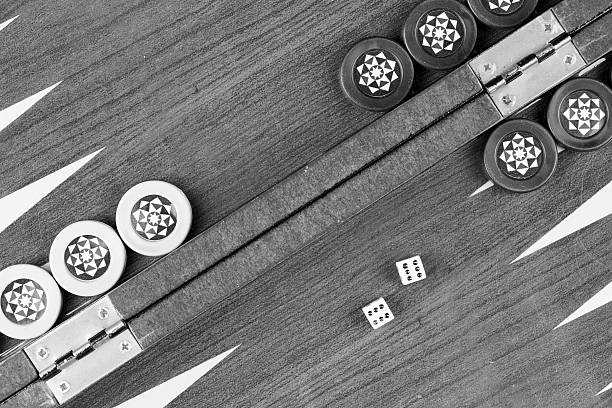 Backgammon table and double six dice closeup black and white stock photo