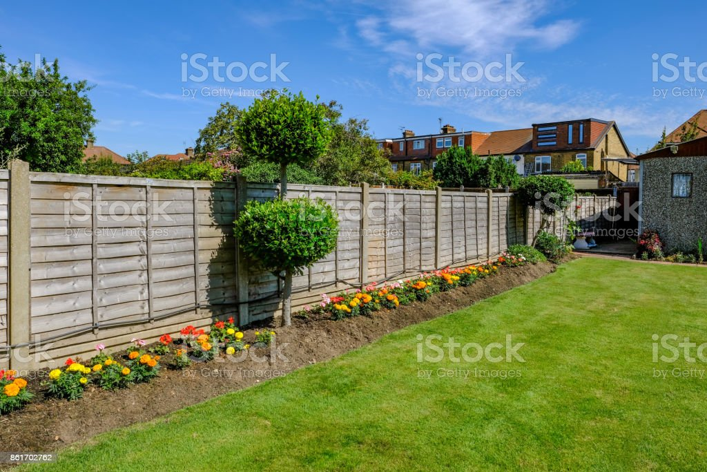 Backgarden flower bed with fence stock photo