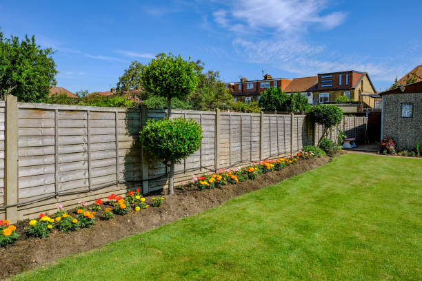backgarden flower bed with fence - fence stock photos and pictures