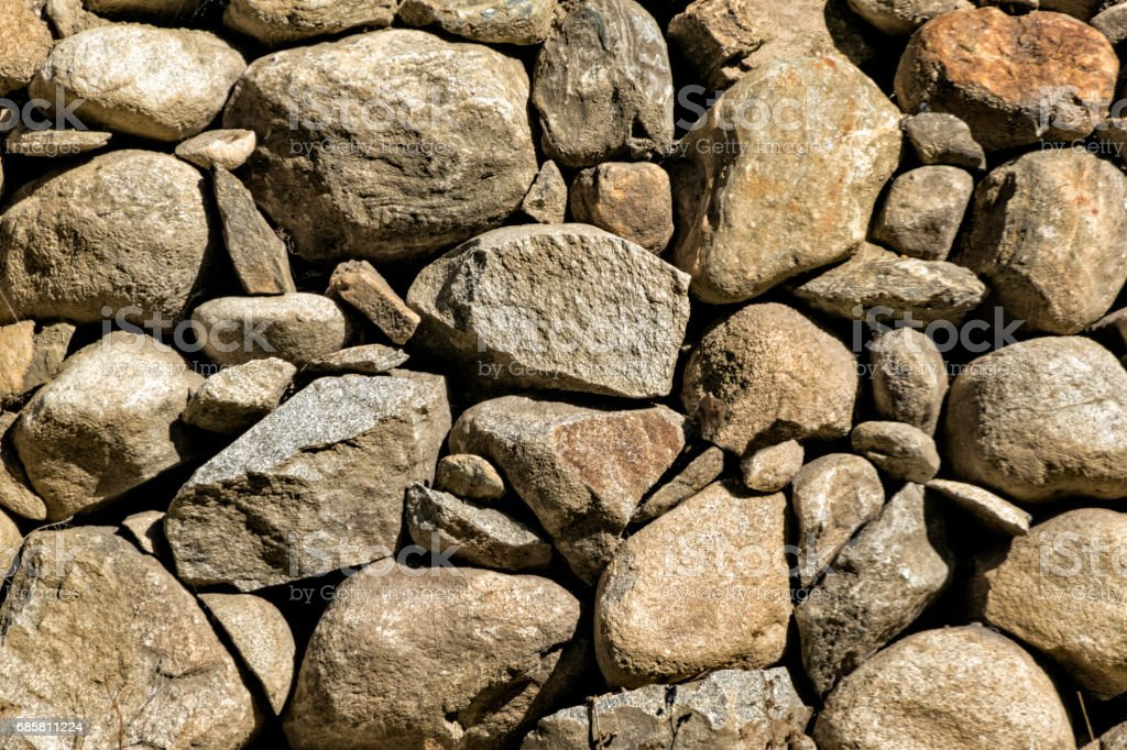Background abstract of a tiled rock wall stock photo