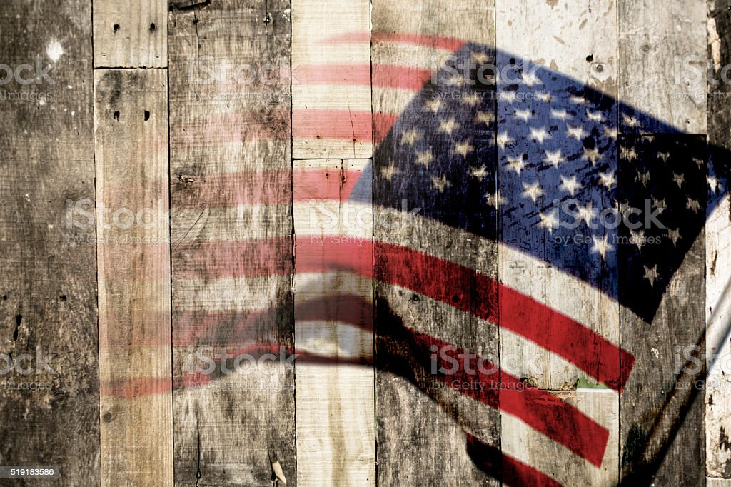 Background:  American flag with wooden background. USA. Patriotism. stock photo