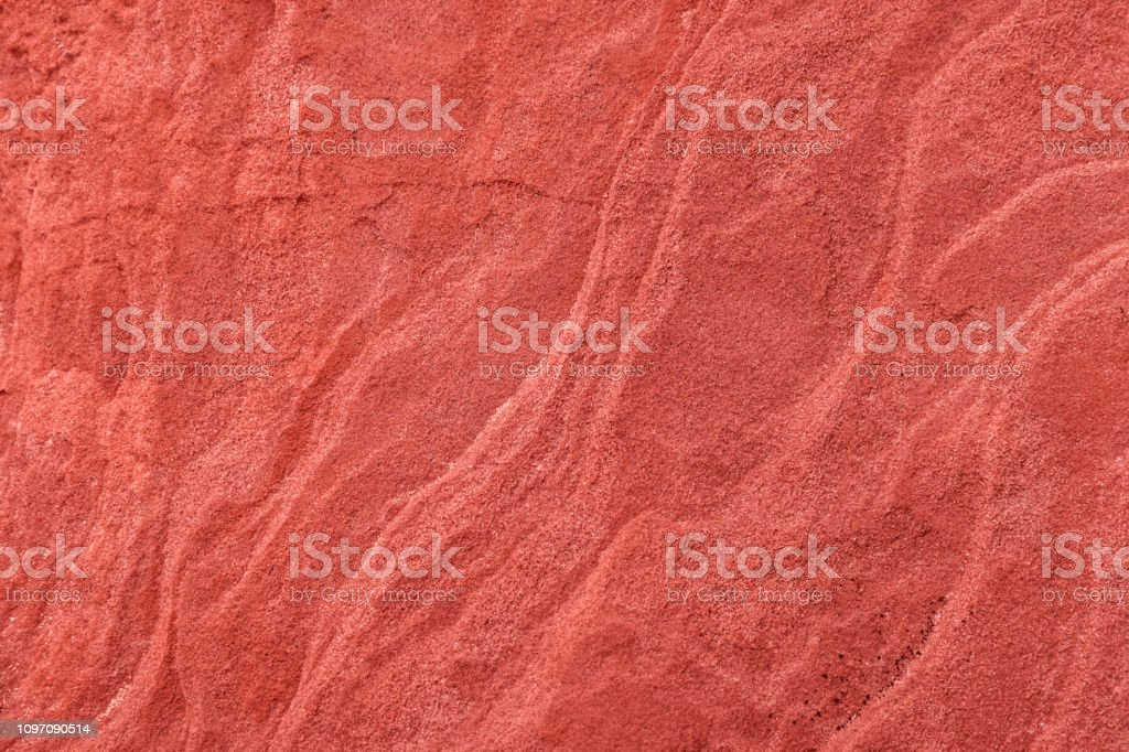 Background and texture in coral color, natural sandstone surface, horizontal composition stock photo