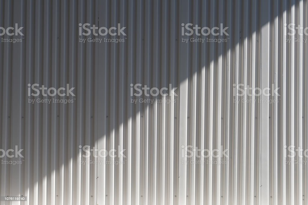 Background and texture of White color corrugated metal sheet with shadow and hilight effect. stock photo