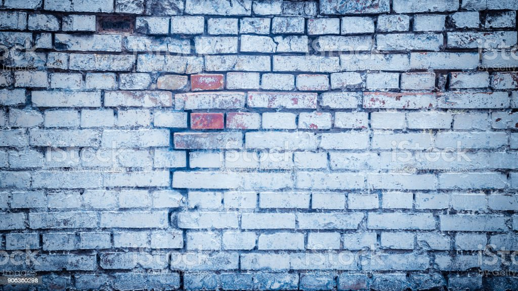 Background blue cracked brick wall texture. stock photo