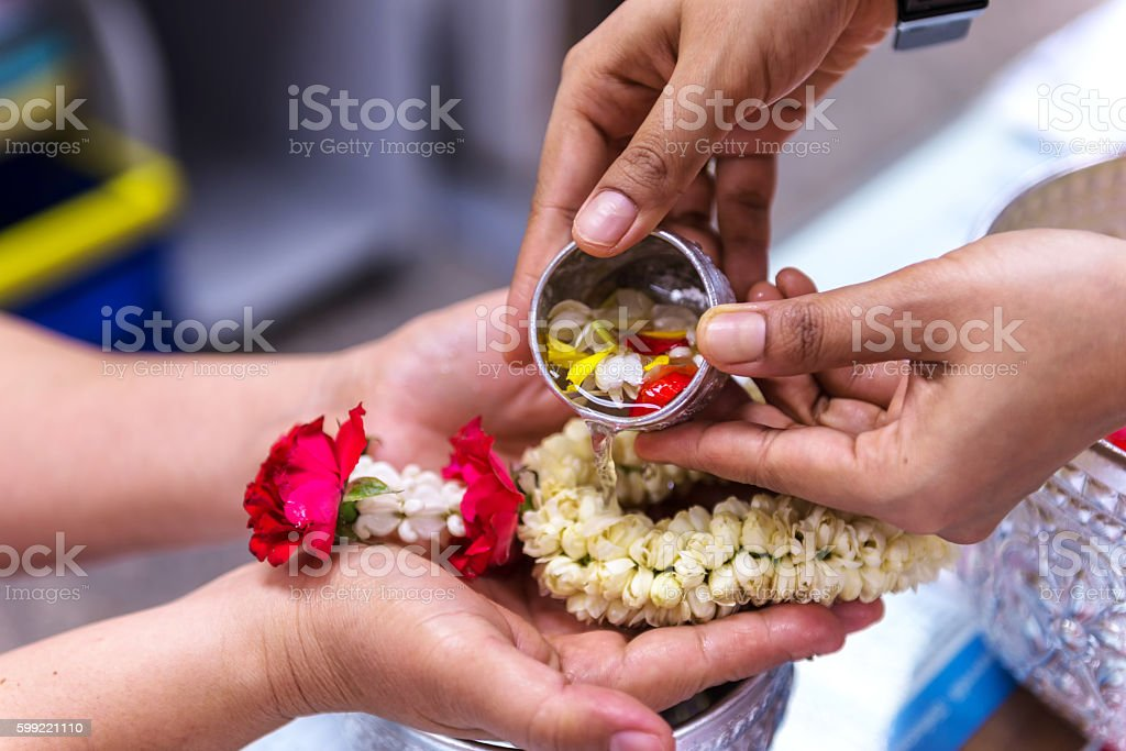 Background blurred Baptist pouring water Buddhist rituals are pu stock photo