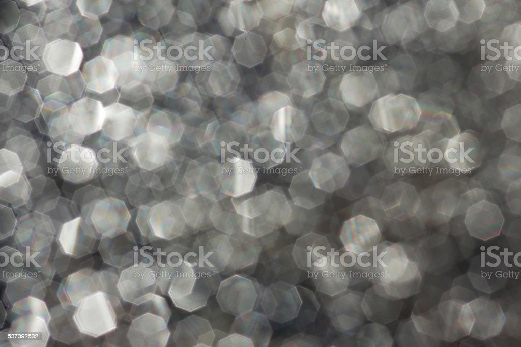 Background - Blurry glittering points on frozen water stock photo