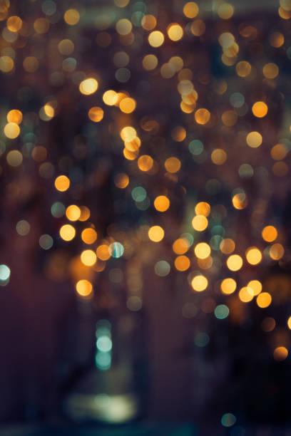 achtergrond bokeh string lights party lights herfst kerstsfeer - snoerverlichting stockfoto's en -beelden