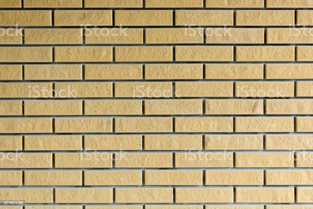 Background. Brick wall of yellow. Brown. royalty-free stock photo