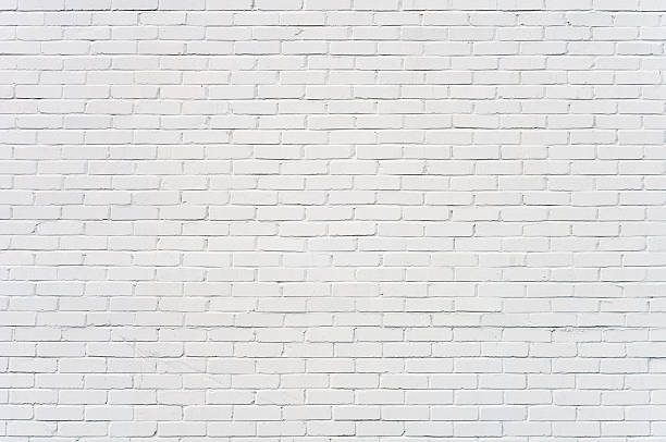Background: brick wall painted white stock photo