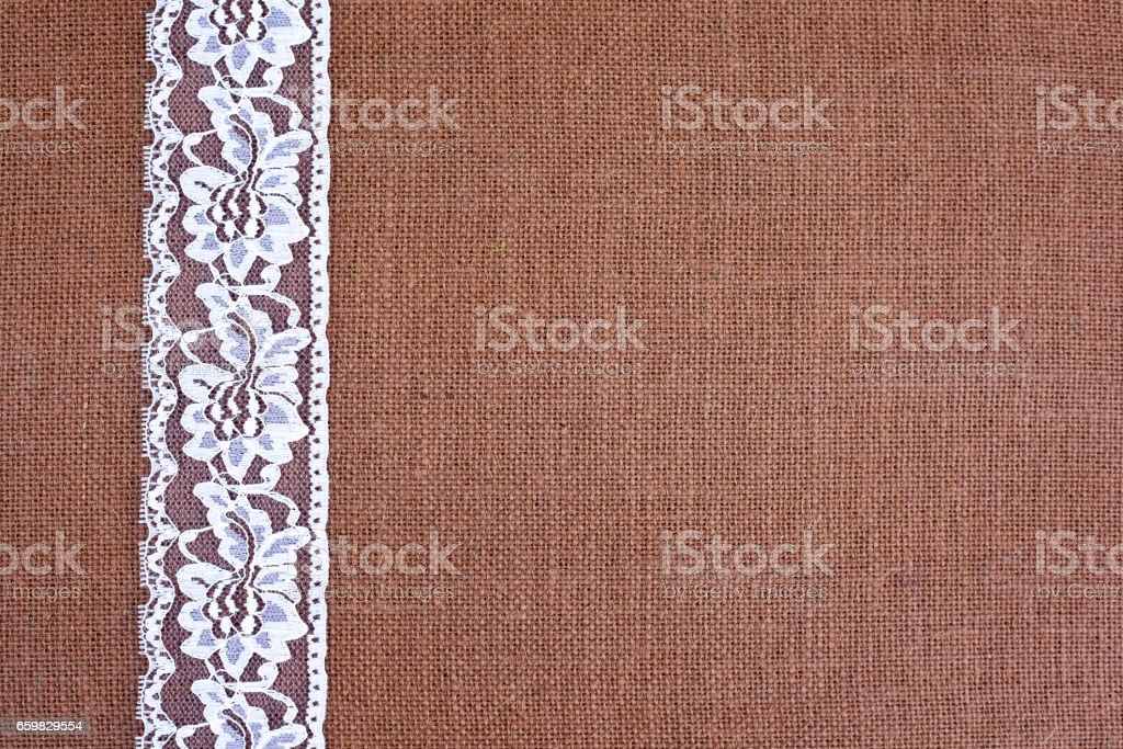 Background Brown Burlap With White Lace Stock Photo