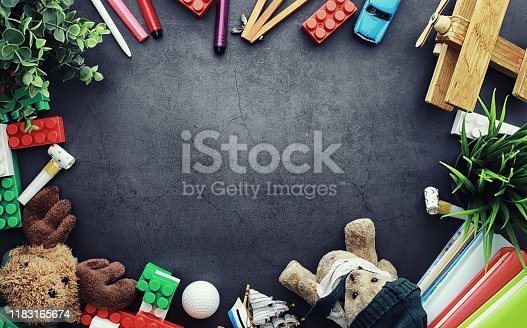 istock Background. Children's toys on the table. Space between kid's toys. 1183165674