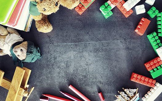 istock Background. Children's toys on the table. Space between kid's toys. 1183537111