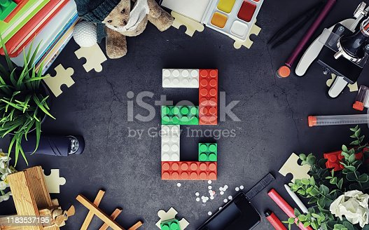 istock Background. Children's toys on the table. Space between kid's toys. 1183537195