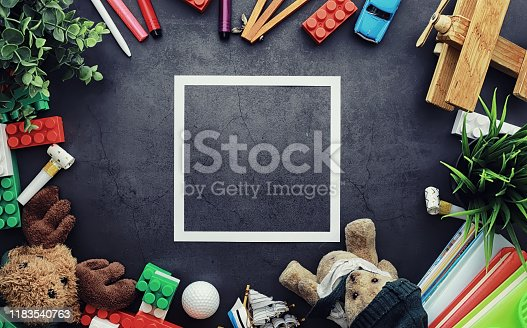 istock Background. Children's toys on the table. Space between kid's toys. 1183540763