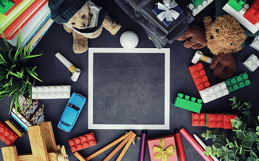 istock Background. Children's toys on the table. Space between kid's toys. 1183540781