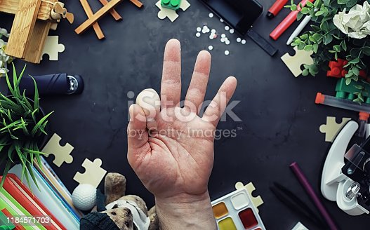 istock Background. Children's toys on the table. Space between kid's toys. 1184571703