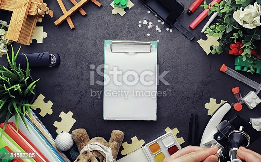 istock Background. Children's toys on the table. Space between kid's toys. 1184587285