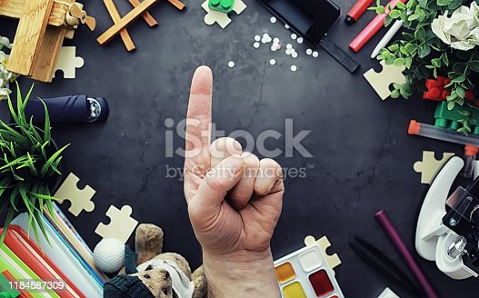 istock Background. Children's toys on the table. Space between kid's toys. 1184587309